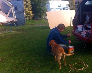 Sheeba helps Gav mix the paint